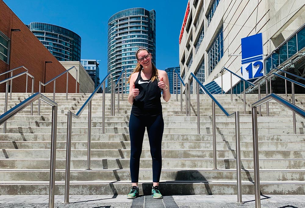 Girl running at the roger centre