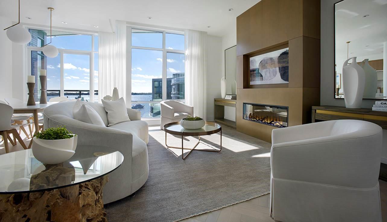 Floor-to-ceiling windows fill Aquavista's sky penthouse suite with natural light