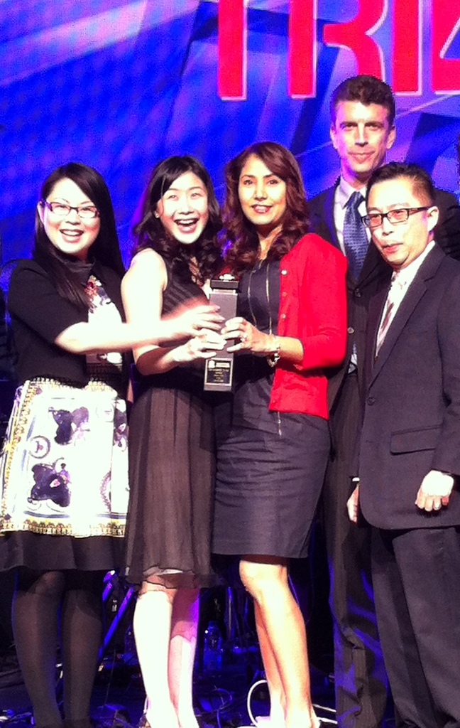 Nasim Radkhoshnoud and Tiffani Tsoi, Best Sales Team of the Year (High rise), with sales managers Winnie Chan and Winson Chan.